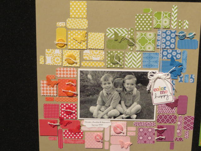 Designer Paper bits and pieces on a scrapbook page