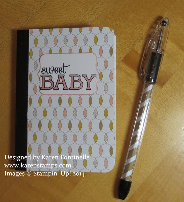 Altered baby notebook and matching pen